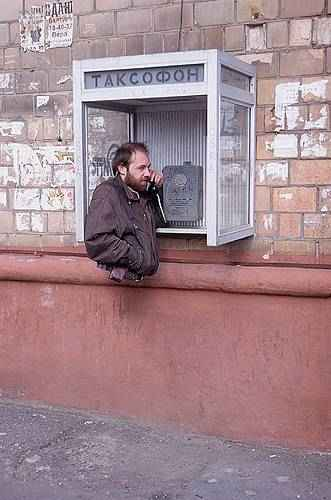 man with no legs floating talking on phone