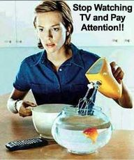 lady watching tv puts mixer in fish bowl