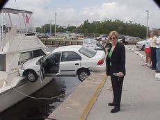 car stuck on boat over water